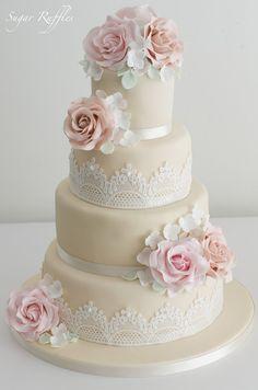 four-tier cream rose wedding cake