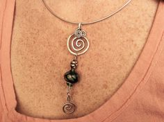 Argentium Sterling Silver and Lampwork Memorial Jewelry. Something special to keep your loved ones close even tho they may be gone...