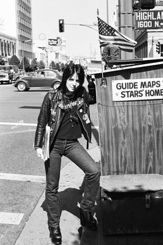 JOAN JETT (1977) | North Highland Ave. & Hollywood Blvd., Los Angeles, CA | Photography: Brad Elterman - The building's exterior on the right is the same but impossible to miss now because of the big green T-Rex on the roof, it's been a Ripley's museum since 1992. The tall building to the left which still stands today is the former First National Bank of Hollywood, built in 1927.