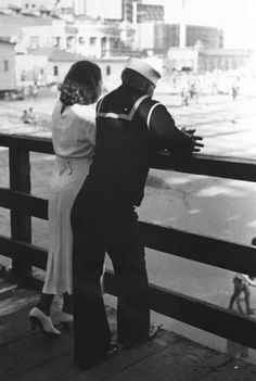 A sailor on shore leave standing on a pier with his girlfriend. Photograph by Peter Stackpole. San Diego, California, 1937.