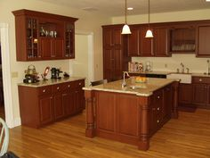 Maple Kitchen shown with Cinnamon stained cabinets