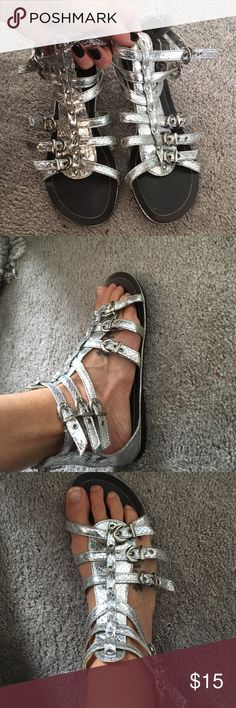 Wild Rose 🌹 gladiator sandals ! Wild rose 🌹 metallic silver gladiator sandals! Stand out and make a statement! No size listed but they are an 8 as that's what I wear. Worn once maybe twice. wild rose Shoes Sandals