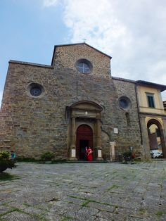 Cortona, wedding couple by the ancient Cathedral dedicated to St. Mary