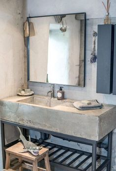 Concrete sink, cool soap dispenser, neat mirror, dried lavender, and THAT SHARK. This salle de bain has funky French written all over it. Industrial Bathroom Design, House Bathroom, Industrial Bathroom Vanity, Concrete Sink, Concrete Bathroom, Industrial Bathroom, Industrial Bathroom Decor, Beautiful Bathrooms, Bathroom Inspiration