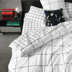 Grid Duvet Cover | Unison | Bring a little order to dreamland. Our black and white cotton bedding with a punchy grid graphic lays things out symmetrically, to soothing effect.