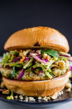 These Thai chicken burgers are packed full of fresh herbs and topped with a crunchy peanut butter slaw. Ready in about 30 minutes and full of flavor!