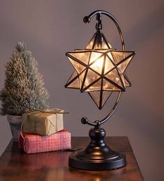 A traditional symbol of Christmas, our handmade Moravian Star Table Lamp adds a warm, peaceful glow wherever you display it. Iridescent, clear glass reflects the light beautifully. Metal frame and stand with black finish. Chandelier bulb not included. Home Interior, Interior And Exterior, Interior Design, Coffee Table Design, Coffee Tables, My New Room, My Room, Deco Design, Design Design