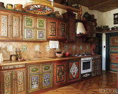 This kitchen has cabinetry painted with folk-art designs.