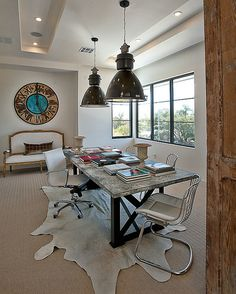 Oversized clock along with giant pendants in the home office