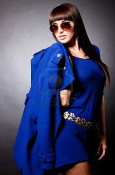 Fashion woman in blue holding a coat   Stock Photo - 11265179