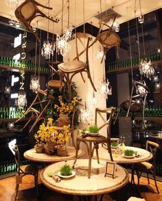 Furniture display at Arhaus... love the chairs hanging from the ceiling!!