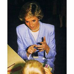 21 July 1988: Princess Diana uses sign language to speak with a special needs child during a visit to Northern Counties School for the Deaf, in Newcastle Upon Tyne