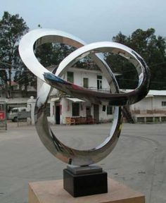 Stainless steel and granite Abstract Public Art Sculptures #sculpture by #sculptor Wenqin Chen titled: 'Infinity Curve (medium)Stainless Steel Circular statues' £3967 #art