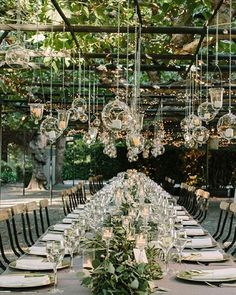 Hanging baubles in a rustic setting give homely and natural beauty to an outdoors wedding