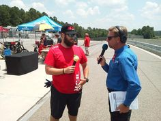 Barry Boone interviews Veterans Empowered Through Motorsports crew member Dallas during the AMA Pro Road Racing Fan Walk at Barber Motorsports Park.