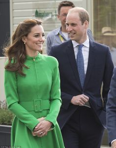 Kate and William were all smiles as they walked through the flower show with William looking at the blooms behind the Duchess