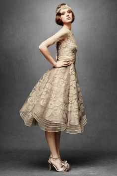 Tulle 50's era gown. Divine! 3/4 sheer sleeves, an illusion neckline and a scalloped tea-length skirt.
