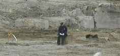 A lone NYPD officer sits at the rubble of Ground Zero on the one year anniversary of the 9/11 attacks which took the lives of his brothers and sisters in uniform, and thousands of others. Never forget. God bless our first responders.
