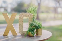 i like that one is glittered and the other one isnt. great idea for table numbers.