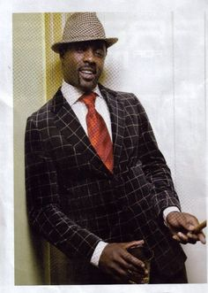 Idris Elba looking fine in his velvet window pane suit.