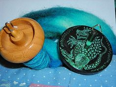 """two of my spindles on this year's Tour de Fleece.   (Bosworth Mini on the left, Yorkieslave """"Roar"""" on the right, and fiber from Miss Babs.)"""