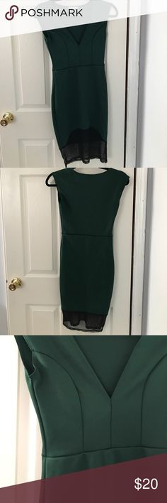 Dark green v neck dress with mesh bottom Dark green deep v neck dress with mesh bottom. Short sleeves and form fitting. Worn just once. In perfect condition! Moving soon offers accepted Charlotte Russe Dresses