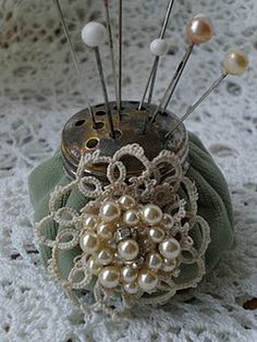 Vintage Pin Cushion - no instructions but this could be recreated using a cheap salt shaker, some stuffing (inside and out), a scrap of velvet, and an applique.
