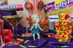 The candy bar was a Seuss hit. The candy reflected the party colors and giant size candy bars and lollipops held court. Little Seuss charact...