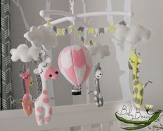 With MUSICAL CRIB ATTACHMENT. Pale pink, yellow, grey & white hot air balloon and giraffes musical rotating mobile. Ready to ship.