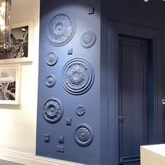 Orac Decor Ceiling Roses have been affixed to this wall and spray painted