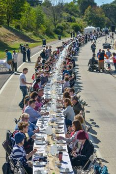 The Innerbelt Freeway was transformed into a giant dinner party for one day! 500 guests from 22 Akron neighborhoods came together at a giant, 500 foot long table, turning this highway into a sociable public space. #LQC #StreetsAsPlaces #Placemaking