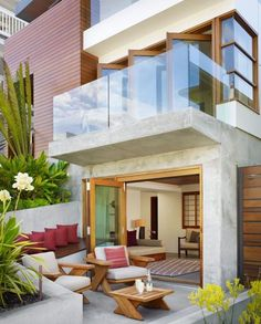 Patio - tropical - patio - los angeles - by Rockefeller Partners Architects. Also, like the balcony room doors. Tropical Patio, Tropical House Design, Tropical Houses, Modern House Design, Modern Tropical, Tropical Decor, Tropical Plants, Outdoor Spaces, Outdoor Living
