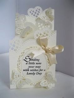 A lovely tri fold card using punches or die cuts along the top for added texture and appeal.