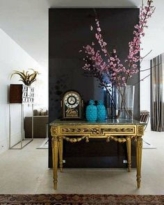 Find stylish examples of black accent walls perfect for a wall in your home that is tough to style. Domino shares photos of black accent walls to try in your home. Home Interior, Interior And Exterior, Interior Decorating, Interior Design, Monochrome Interior, Decorating Games, Decorating Websites, Hallway Decorating, Black Accent Walls