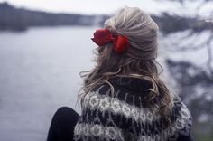 asymmetric red bow and hippie sweater.  i want to go sit by a lake now...