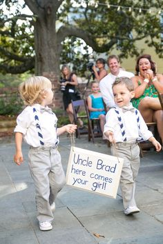 These ring bearers are so adorably stylish! Love the sign idea. | Dana Cubbage Weddings