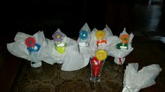 Got 6 shot glasses from big lots, dressed them up with tissue paper and candy , I found the cute candy at party city . Using these for baby bingo.