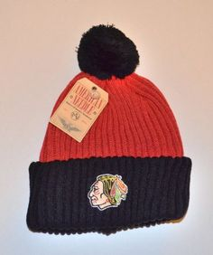 Chicago Blackhawks 2-Tone Dappy Beanie Hat with Pom - NHL Cuffed Winter Knit Toque Cap by American Needle. $14.39. Keep warm and show your NHL team pride with this stylish beanie hat with Pom! Purchase with confidence from WaveCaps...all our beanie hats ship out same day with authentic NHL tags attached. Save 42%!