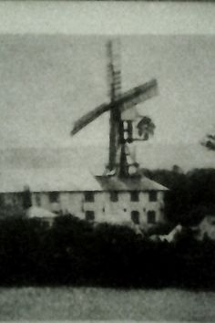 The unusual windmill /watermill combination at West Ashling, near Chichester in about 1910. The Windmill was a type of Hollow Post Mill which operated the sack hoist in the water Mill plus additional millstones. It stopped working in around 1910 and was demolished in the early 1950s, the sails having been removed in the 1930s.