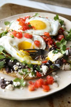A nice twist on Huevos Rancheros, that are loaded up with greens for a nice healthy touch.
