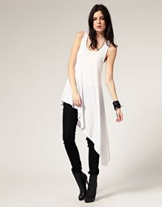 Same top then tight black Pants  with white boots and a black necklace black earingS that should do it