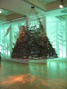 """Unconventional Christmas Tree christmas tree made out of """"walise"""" or brooms - bank of the"""