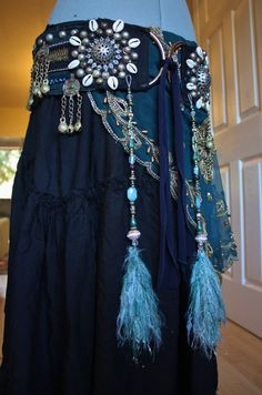 Made with reeeeaaal super soft unicorn hair (or sparkle novelty yarn for the non-believer) this pair of tassels has lots of pretty teal and cream! Features 2 gorgeous gold and cream vintage lucite beads, big teal faceted glass with white swirls, lots of brass spacers, Czech glass, and other vintage rescues.    These tassels are incredibly versatile! You can sew them or hang them from a jumpring to just about any element of your costume- a headpiece, hairflower or clip, a bra, belt, shawl…
