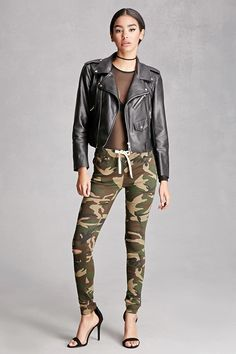 A pair of knit skinny pants featuring an allover camo print, elasticized drawstring waistband, a low-rise, distressed knee cutouts, and a five-pocket construction. This is an independent brand and not a Forever 21 branded item.