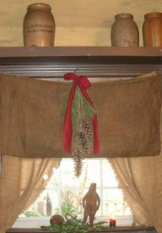 For above my kitchen window?? Loving the red bow and the crocks above. . .