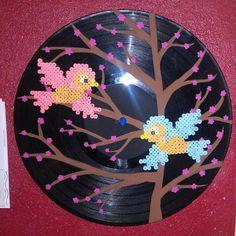 Vinyl record with perler beads sparrow birds and cherry blossom tree art by ValeriasMarvels