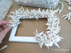 A small frame covered completely with worm shells. Very pretty! Follow link for full tutorial.
