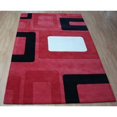 @Overstock - This hand-tufted area rug features custom dyed yarns and a geometric design. This area rug has a color pallet featuring red, black and white. http://www.overstock.com/Home-Garden/Hand-tufted-Metro-Classic-Red-Wool-Rug-5-x-8/5092622/product.html?CID=214117 $165.99