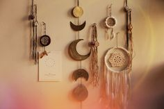 Wall decor- dream catchers, moon phase garland, and hanging crystals