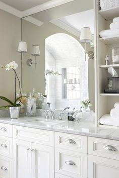 bathroom- i love the drawer handles and the large mirror plus the white look
